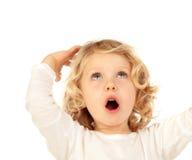 Überraschtes blondes Kind mit blauen Augen Lizenzfreies Stockbild
