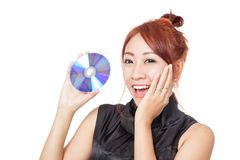 Überraschtes entzückendes asiatisches Mädchen mit einer Diskette Stockbilder