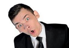 Überraschtes Gesicht des Geschäftsmannes Stockfotografie