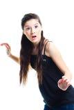 Überraschtes Jugendlichmädchen auf getrenntem Weiß Lizenzfreies Stockfoto