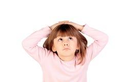 Überraschtes kleines Mädchen, das Gesten macht Lizenzfreies Stockfoto