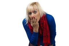Überraschtes Mädchen, das ihren Mund bedeckt Stockbilder