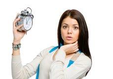 Überraschtes Mädchen mit Wecker Lizenzfreie Stockfotografie