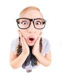 Überraschtes nerdy Mädchen Stockfotografie