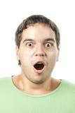 Überraschtes Portrait des jungen Mannes getrennt auf Weiß Lizenzfreies Stockfoto