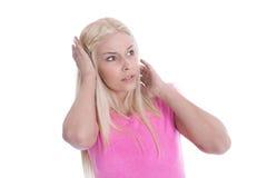 Überraschtes und entsetztes lokalisiertes junges Mädchen lokalisiert über Weiß. Stockfoto