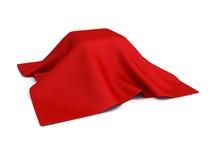Überraschungskasten bedeckt mit rotem Stoff Stockfoto