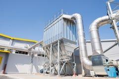 Überschüssiger Silo, wenn Abfall zur Energiepflanze aufbereitet wird Stockbild