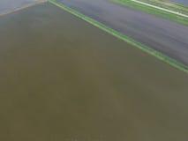 Überschwemmte Reispaddys Landwirtschaftliche Methoden des Anbauens des Reises auf den Gebieten Lizenzfreie Stockfotos