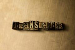 ÜBERSETZT - Nahaufnahme der grungy Weinlese setzte Wort auf Metallhintergrund Lizenzfreie Stockfotografie
