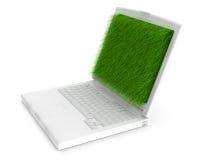 Übertragenes weißes Notizbuch mit Gras Lizenzfreie Stockbilder