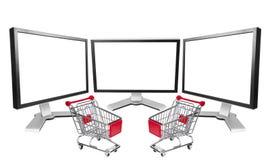 Überwachungsgerät mit drei Computern mit Marktwagen Lizenzfreie Stockfotos
