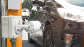 Überwachungskameraüberwachung auf Autoparkensicherheitssystembereich contr Stockfotos
