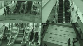 Überwachungskameramonitor im Mall Der Schirm wird in 4 Teile unterteilt System der Sicherheits-, Diebstahl- und Terrorismusverhin stock video