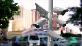 Überwachungskameras in einer verkehrsreichen Straße lizenzfreie abbildung