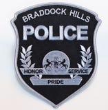 Überwundenen schwarzen und silbernen BRADDOCK-HÜGEL ÜBERWACHEN Schulterflecken auf einem weißen Hintergrund polizeilich lizenzfreie stockfotografie