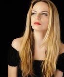 Überzeugte blonde Frau Lizenzfreie Stockfotos