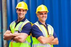 Überzeugte Hafenarbeitskräfte Lizenzfreie Stockbilder