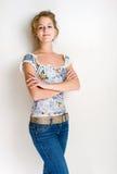 Überzeugte junge blonde Frau. Lizenzfreie Stockfotos