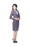 Überzeugte junge Geschäftsfraustellung stockfotografie
