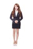 Überzeugte junge Geschäftsfraustellung stockfoto