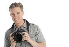 Überzeugte männliche Fotograf-With Camera And-Regenschirm-Lichter Lizenzfreie Stockfotos