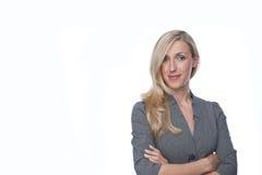 Überzeugte stilvolle blonde Geschäftsfrau Stockfotografie