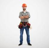 Überzeugter Arbeiter mit Werkzeugen Lizenzfreie Stockfotos