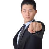 Überzeugter asiatischer Geschäftsmann mit der Faust Stockfotografie