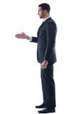 Überzeugter Geschäftsmann, der Ihnen eine Handerschütterung gibt Stockbilder