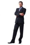 Überzeugter Geschäftsmann, der mit den gefalteten Händen steht. Lizenzfreie Stockfotografie