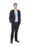 Überzeugter Geschäftsmann Standing With Hands in den Taschen Stockfoto