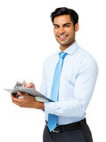 Überzeugter Geschäftsmann Writing On Clipboard stockbilder