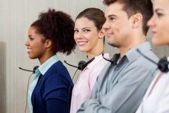 Überzeugter Kundendienstmitarbeiter Standing Stockbilder