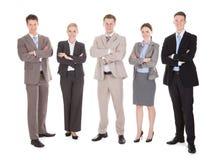 Überzeugtes Geschäft Team Standing Arms Crossed Stockfotos