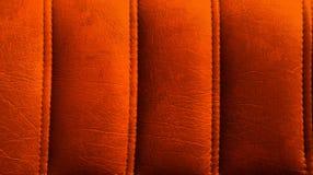 Überziehen Sie Hintergrund mit Leder Stockfotos