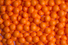 Überzogene orange Süßigkeit Lizenzfreie Stockfotos