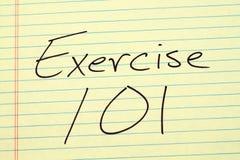 Übung 101 auf einem gelben Kanzleibogenblock Lizenzfreies Stockfoto