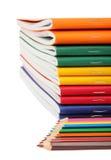 Übungsbücher und -bleistifte Lizenzfreie Stockbilder