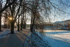 Ülejõe park near the embankment of the Emajõgi river in Tartu, Estonia. Ülejõe park near the embankment of the Emajõgi river and pedestrian bridge Kaarsild Royalty Free Stock Photo