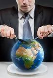 Żądna biznesmena rozcięcia planety ziemia Obraz Royalty Free