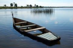 Łódź wypełniająca woda Obrazy Royalty Free