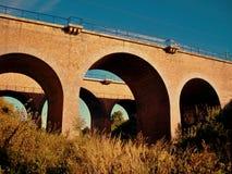 Łękowaty most w słońcu Obrazy Stock