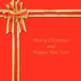łęku faborek dekoracyjny złocisty czerwony Fotografia Royalty Free