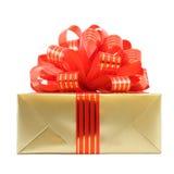 łęku prezenta złota teraźniejsza czerwień paskował target545_0_ Fotografia Royalty Free