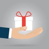 łęku pudełkowaci prezenta ręki czerwieni faborki Zdjęcie Stock