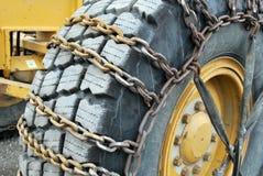 łańcuchów równiarki drogowa opona Zdjęcie Stock