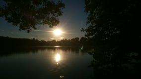 łańcuchu pokryw horyzontalnych Illinois jeziornych jezior lekka o pomarańczowa fotografii nieba zmierzchu powierzchnia usa Zdjęcie Stock