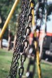 Łańcuchy bawić się w parku zdjęcie royalty free