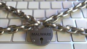 Łańcuchy i kłódka z MALWARE tekstem na komputerowej klawiaturze Konceptualna 3D animacja royalty ilustracja